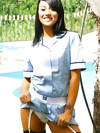 Penelope the dark haired beauty in a nurse uniform with..