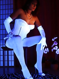 Model Nadja wearing white lingerie during blacklight session