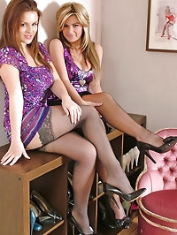 Some beautiful ladies wearing lace top stockings and high..
