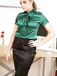 Naomi dressed as a secretary in a tight green blouse and..