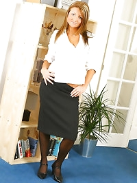 Ravishing redhead in smart office outfit with gorgeous red..