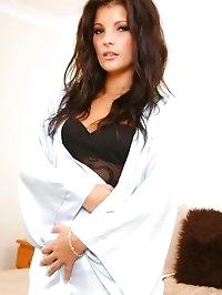 Brunette looks stunning wearing black lingerie and..