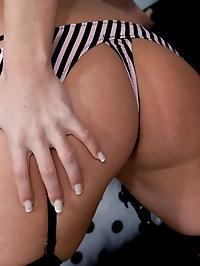 Nikki In A Pink Black Bikini