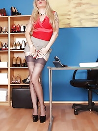 Hot blonde Alina dressed in short skirt, stockings and..