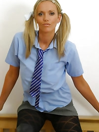 Lucy Zara in college uniform with black patterned pantyhose