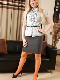 Sexy secretary shows off her very snazzy tights.