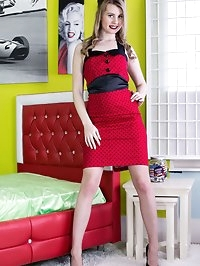 Brooke looking divine in a tight dress over a corselette..