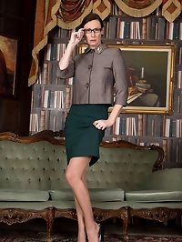 Office manager, Lara, as a nylon wearing mature..