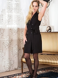 A black evening gown and stockings hug Elegant Eves..