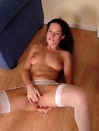 Athena dressed in sexy stockings fingers her pussy and ass