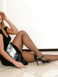 Hot leggy blonde Kathryn buckles up her high heels in sexy..