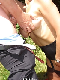 Jane takes a load on her tits as she poses in the park