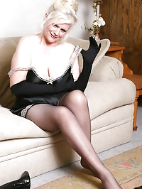 Playful 61 year old Zoe from AllOver30.com poses in nylons