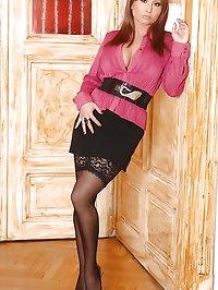Busty hot babe Selina stripteasing