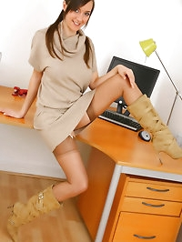 Lovely Nadia E teases us in her office as she slips off..