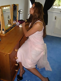 Nylon Jane brushing her hair and taking off negligee