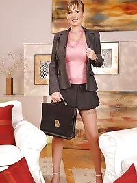Busty business woman Edo strips off