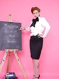 Strict teacher Elle Richie in black stocking stripteases..